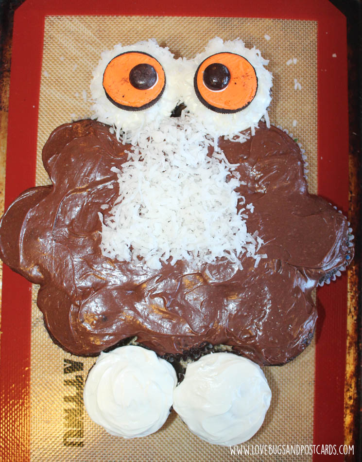 Add the eyes to the Owl Cupcake Cake