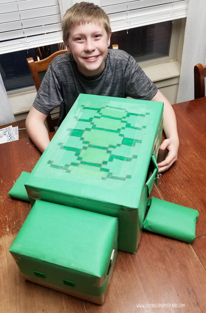 Add the turtle shell design, eyes, nose, and mouth to finish the Minecraft Turtle Valentine's Box