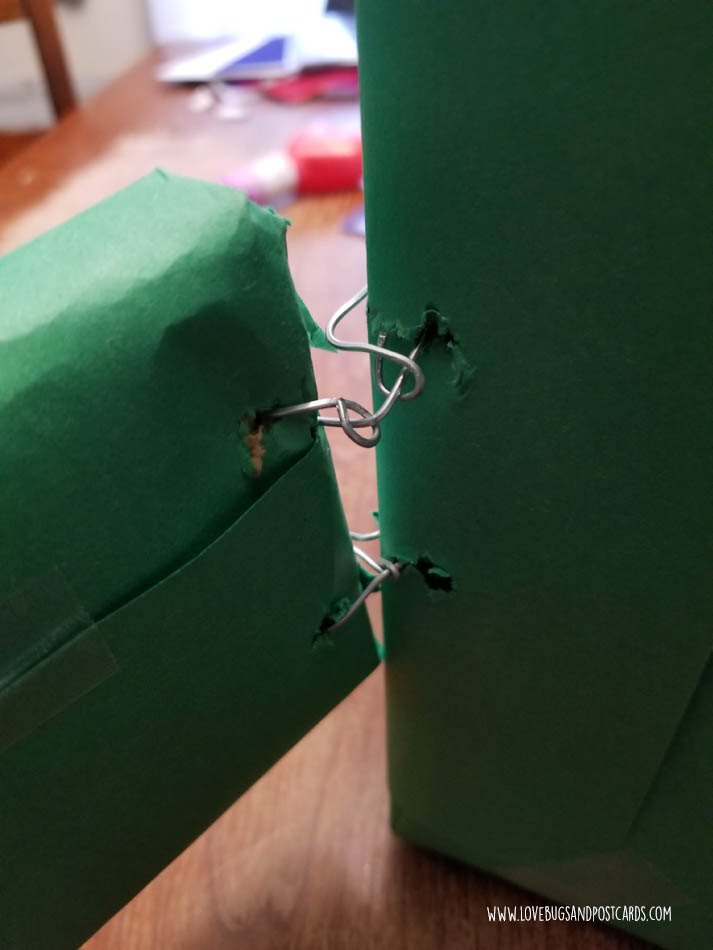Attach the legs to the box using wire