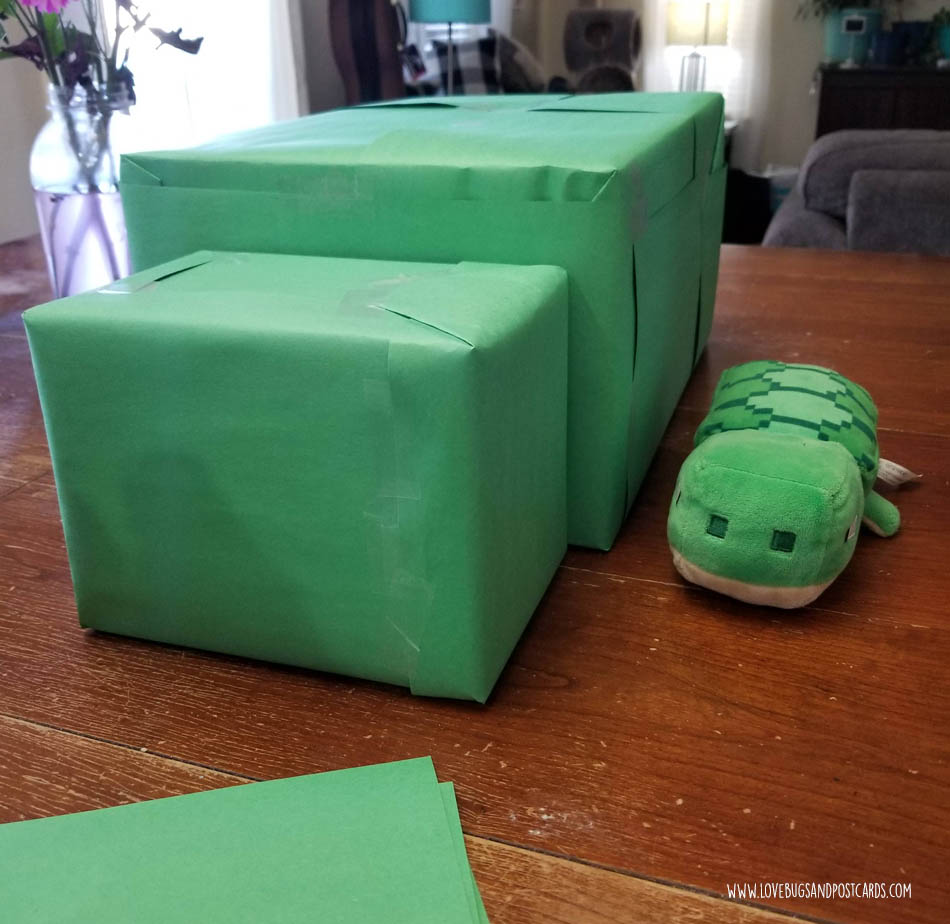 Two boxes for a Minecraft Turtle wrapped in green paper