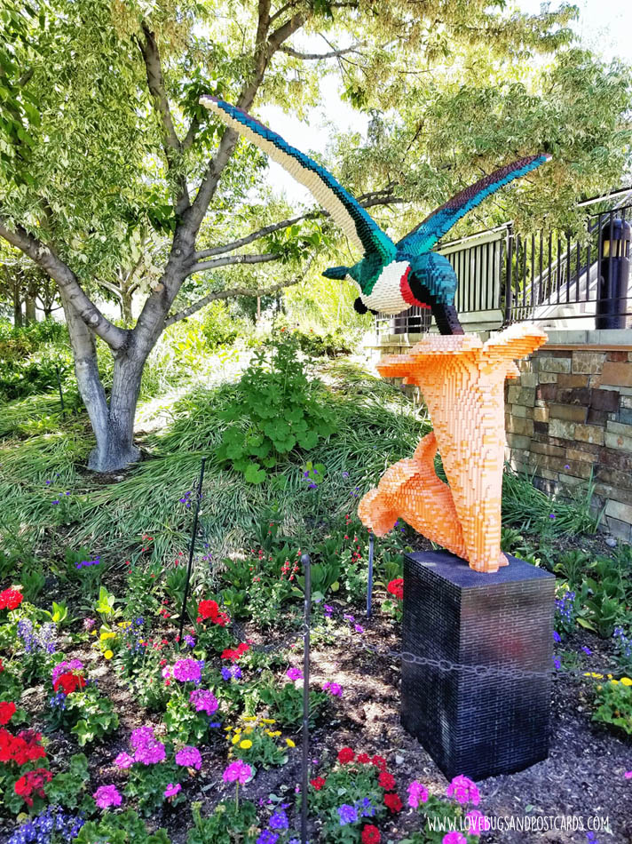 Sean Kenney's Nature Connects Made with LEGO® Bricks at Thanksgiving Point - Hummingbird Feeding from Trumpet Flower